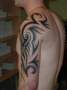 Half Tribal Sleeve Tattoos