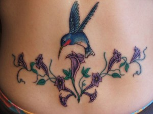 Tribal Hummingbird with Flower Tattoo