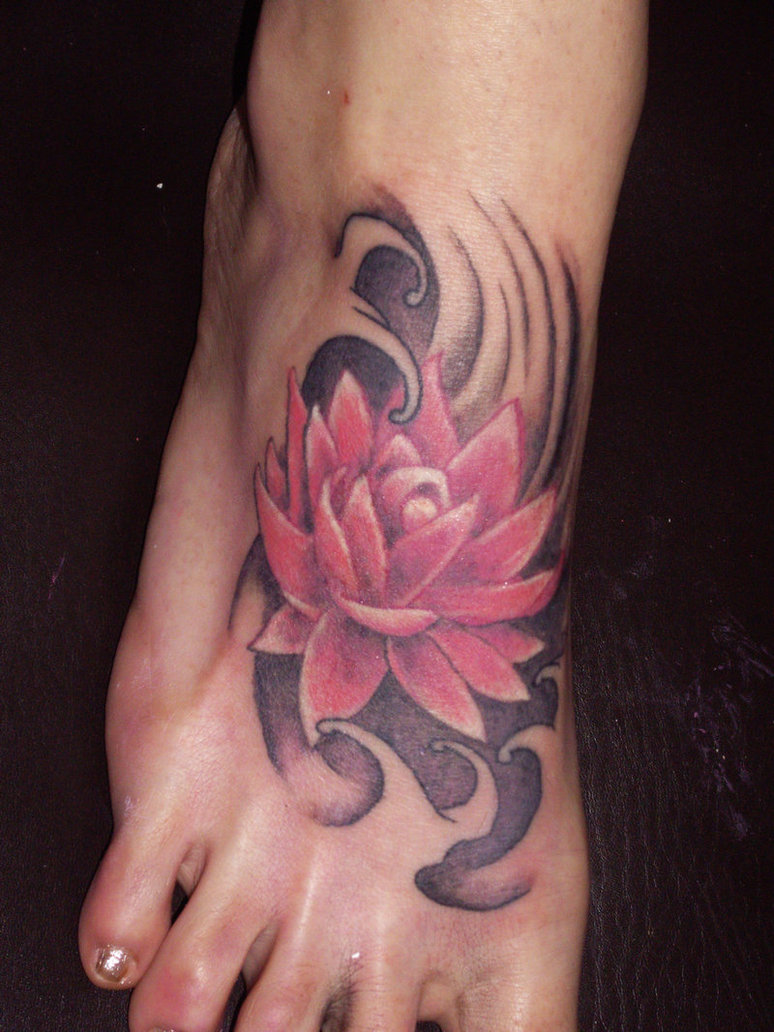 11 beautiful tribal lotus flower tattoos only tribal tribal lotus flower tattoo on foot izmirmasajfo Choice Image