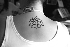 Tribal Lotus Flower Tattoo on Neck