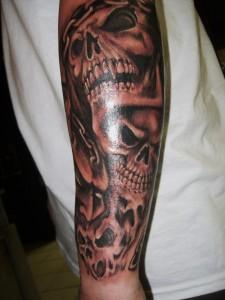 Tribal Skull Sleeve Tattoos