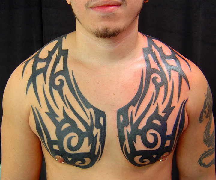 45 Intriguing Chest Tattoos For Men: 25 Beautiful Tribal Chest Tattoos