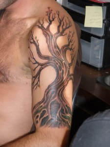 Tribal Tree Sleeve Tattoo