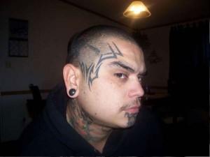 Face Tribal Tattoo