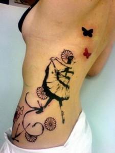 Female Tribal Rib Tattoos