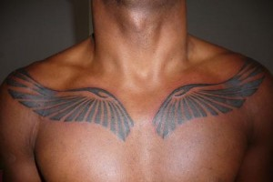 Tribal Wings Tattoo on Chest